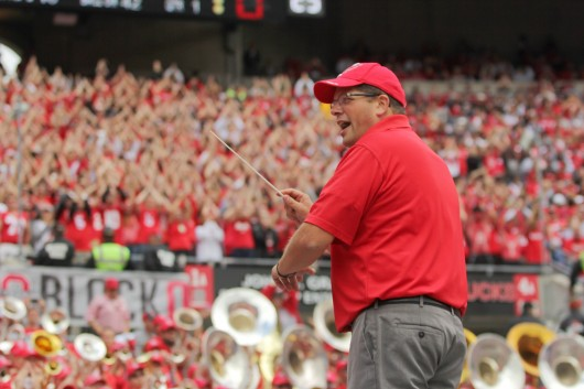 Former OSU Marching Band director directs the alumni band during Sept. 13's game against Kent State. Credit: Mark Batke / Photo editor