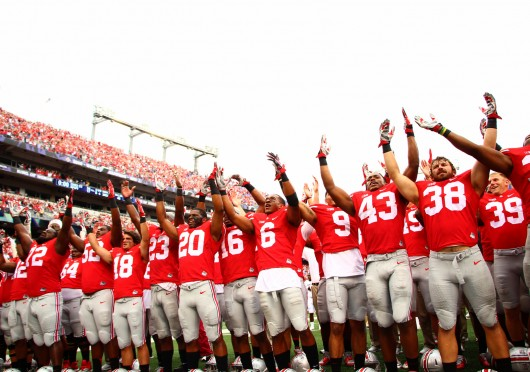 """OSU players sing """"Carmen Ohio"""" following a 34-17 win against Navy at M&T Bank Stadium in Baltimore on Aug. 30. Credit: Mark Batke / Photo editor"""