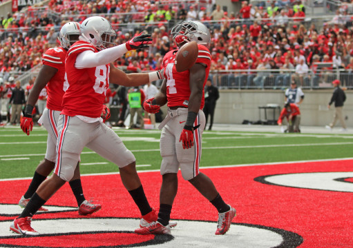 Freshman running back Curtis Samuel (4) celebrates with redshirt-freshman tight end Marcus Baugh during a game against Kent State on Sept. 13 at Ohio Stadium. OSU won, 66-0.  Credit: Mark Batke / Photo editor