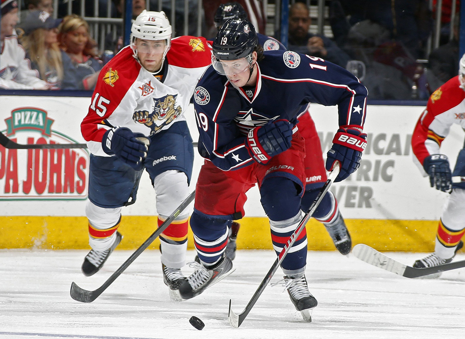Columbus Blue Jackets center Ryan Johansen (19) carries the puck up ice in front of the Florida Panthers' Drew Shore (15) during a game at Nationwide Arena in Columbus on  March 1, 2014. Columbus won, 6-3. Credit: Courtesy of MCT