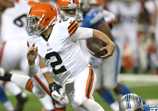 Cleveland Browns quarterback Johnny Manziel (2) evades the Detroit Lions' Kyle Van Noy (95) during the second quarter in exhibtion action on Aug. 9 at Ford Field in Detroit. Credit: Courtesy of MCT