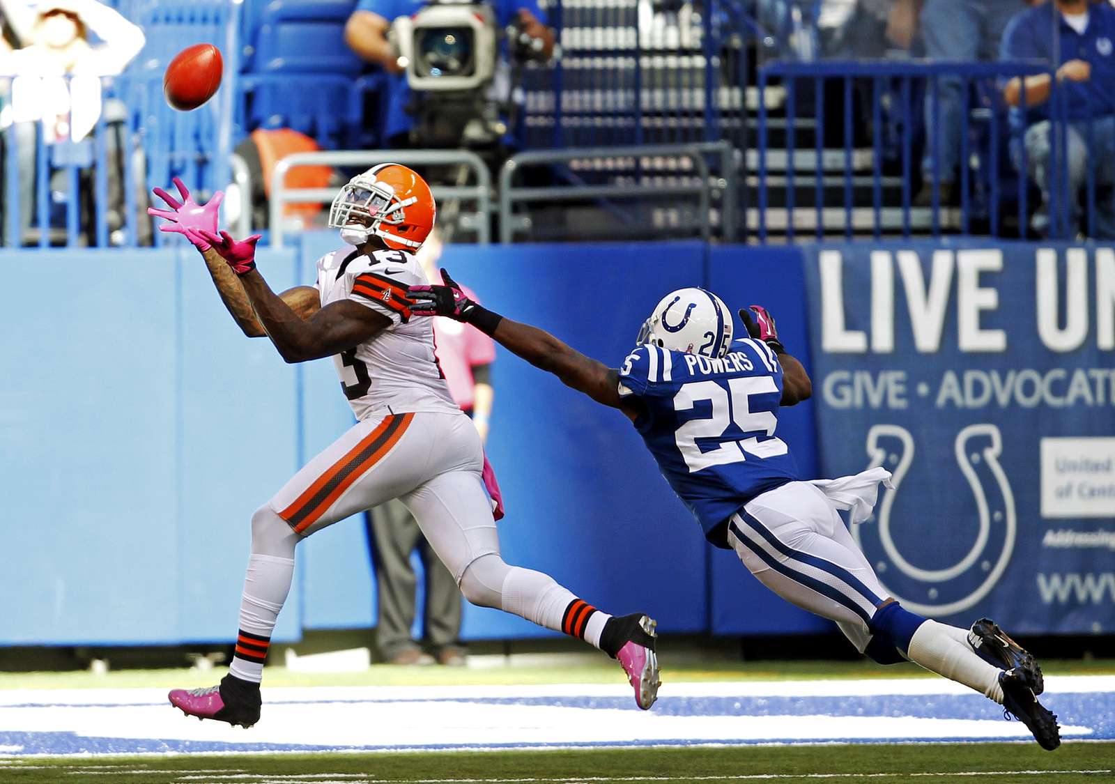 Cleveland Browns wide receiver Josh Gordon (13) just misses a catch that would have been a touchdown against Indianapolis Colts cornerback Jerraud Powers (25) on a play during second half action on Oct. 21, 2012, in Indianapolis. The Colts won, 17-13. Credit: Courtesy of MCT
