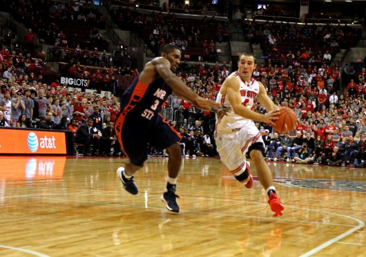 Then-senior guard Aaron Craft (4) drives to the basket during OSU's 89-50 win against Morgan State on Nov. 9, 2013. After not being selected in the 2014 NBA Draft, Craft signed as a free agent with the Golden State Warriors. Credit: Lantern file photo