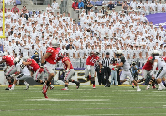Redshirt-freshman quarterback J.T. Barrett (16) attempts a pass to senior wide receiver Devin Smith (9) during a game against Navy Aug. 30 at M&T Bank Stadium in Baltimore. OSU won, 34-17. Credit: Mark Batke / Photo editor