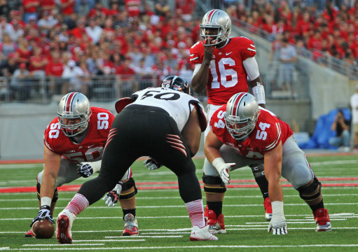 Redshirt-freshman quarterback J.T. Barrett waits for the snap during a game against Cincinnati on Sept. 27 at Ohio Stadium. OSU won, 50-28, behind 409 yards of total offense from Barrett. Credit: Mark Batke / Photo editor