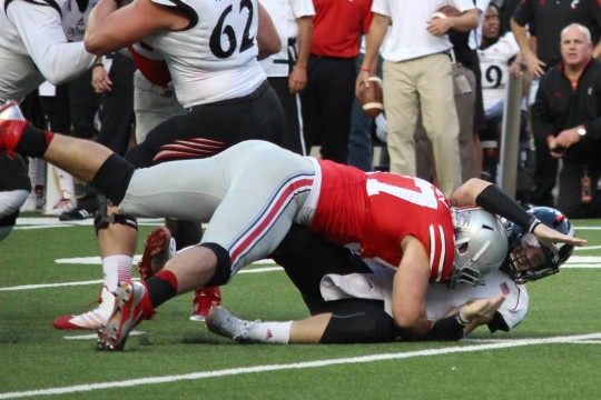 OSU sophomore defensive lineman Joey Bosa sacks Cincinnati redshirt-sophomore quarterback Gunner Kiel in a game Sept. 27 at Ohio Stadium. OSU won 50-28 Credit: Chelsea Spears / Multimedia editor