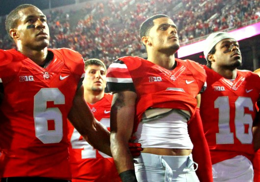From left: Senior Evan Spencer, senior Devin Smith and sophomore Cam Burrows sing 'Carmen Ohio' following a 35-21 loss to Virginia Tech Sept. 6.  Credit: Mark Batke / Photo editor