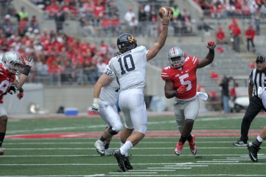 OSU freshman linebacker Raekwon McMillan (5) pressures the Kent State quarterback during a game Sept. 13. OSU won 66-0. Credit: Mark Batke / Photo editor