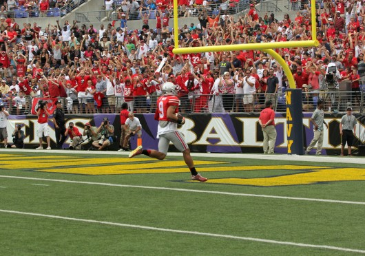 OSU senior wide receiver Devin Smith attempts to catch a pass during a game against Navy at M&T Bank Stadium in Baltimore on Aug. 30. Smith finished with 94 yards receiving on the day and one touchdown. Credit: Mark Batke / Photo editor