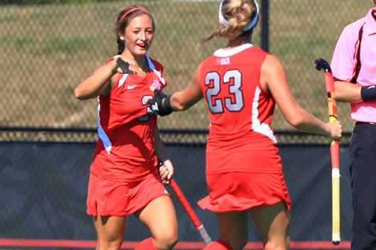 Junior forward Peanut Johnson (3) celebrates with freshman midfielder Maddy Humphrey (23) during a game against Syracuse on Aug. 29 in Columbus. OSU lost, 3-2, in overtime.  Credit: Courtesy of OSU athletics