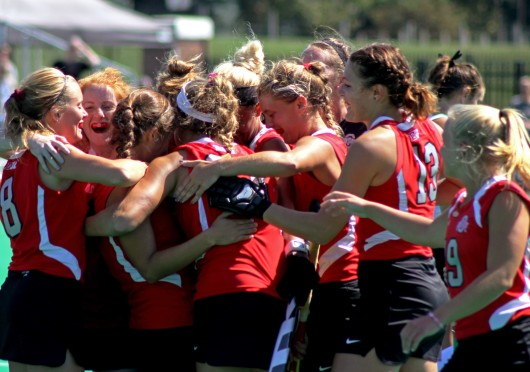 Members of the OSU field hockey team celebrate during a game against Ball State on Sept. 14 at Buckeye Varsity Field. OSU won, 3-2, in overtime. Credit: Melissa Prax / Lantern photographer