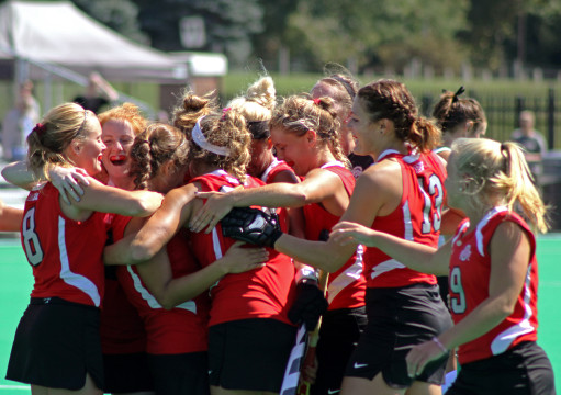 Members of the OSU field hockey team celebrate at a game against Ball State on Sept. 14 at Buckeye Varsity Field. OSU won, 3-2, in overtime. Credit: Melissa Prax / Lantern photographer