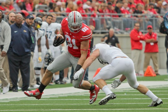 OSU redshirt-junior tight end Nick Vannett (81) carries the ball during a game against Kent State on Sept. 13 at Ohio Stadium. OSU won, 66-0. Credit: Mark Batke / Photo editor