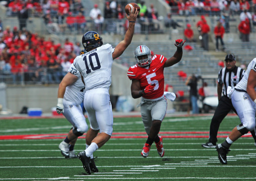 OSU freshman linebacker Raekwon McMillan (5) rushes Kent State redshirt-sophomore quarterback Colin Reardon (10) during a game against the Golden Flashes on Sept. 13 at Ohio Stadium. OSU won, 66-0. Credit: Mark Batke / Photo editor