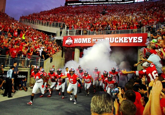 Members of the Ohio state football team run out of the new players' enterance tunnel before a matchup with Virginia Tech on Sept. 6 at Ohio Stadium. OSU los, 35-21. Credit: Mark Batke / Photo editor