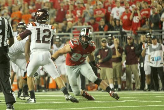 Sophomore defensive lineman Joey Bosa (97) rushes toward Virginia Tech redshirt-junior quarterback Michael Brewer (12) during a game Sept. 6 at Ohio Stadium. OSU lost, 35-21. Credit: Mark Batke / Photo editor