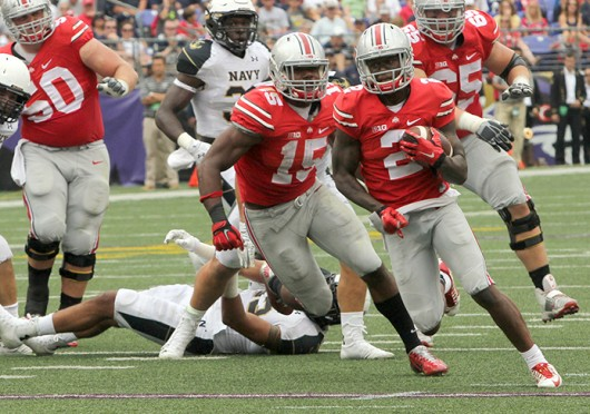 Sophomore H-back Dontre Wilson (2) carries the ball past blocks from junior offensive lineman Jacoby Boren (50), sophomore running back Ezekiel Elliott (15) and redshirt-sophomore offensive lineman Pat Elflein (65) during a game against Navy Aug. 30 at M&T Bank Stadium in baltimore. OSU won, 34-17.  Credit: Mark Batke / Photo editor