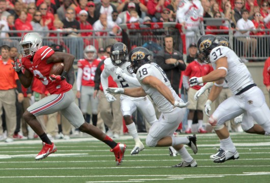 OSU redshirt-sophomore wide receiver Michael Thomas (left) outruns defenders following a catch against Kent State on Sept. 13 at Ohio Stadium. Thomas led OSU in receiving with 77 yards on 2 catches with a touchdown in OSU's 66-0 win. Credit: Mark Batke / Photo editor