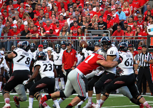 OSU sophomore defensive lineman Joey Bosa (left) forces a fumble from Cincinnati redshirt-sophomore quarterback Gunner Kiel during a Sept. 27 game at Ohio Stadium. The fumble resulted in an OSU safety. Credit: Chelsea Spears / Multimedia editor