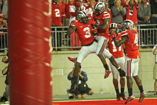 OSU redshirt-sophomore Michael Thomas (3) celebrates with teammates (from left) Dontre Wilson, Vonn Bell and Curtis Samuel after a touchdown during a game against Virginia Tech on Sept. 6 at Ohio Stadium. OSU lost, 35-21. Credit: Mark Batke / Photo editor