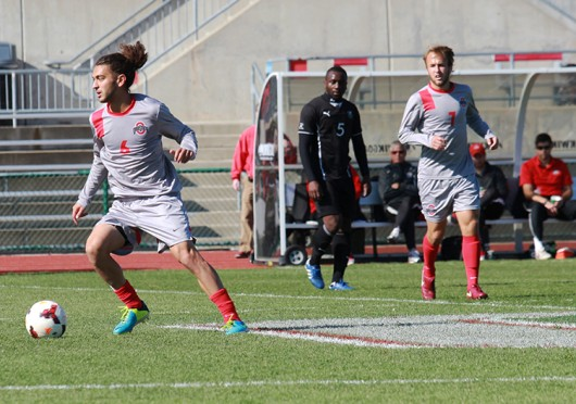Then-junior midfielder Yianni Sarris dribbles during a game against Cleveland State Oct. 27. OSU won, 1-0. Credit: Mark Batke / Photo editor