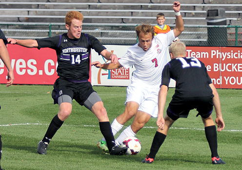 Then-sophomore forward Zach Mason (7) dribbles the ball during a game against Northwestern on Oct. 20, 2013. OSU tied the Wildcats, 0-0, after two overtimes. Credit: Lantern file photo