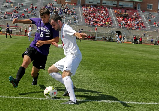 Junior defender Kyle Culbertson (3) fights to keep the ball in bounds during a game against Northwestern on Sept. 14 at Jesse Owens Memorial Stadium. OSU won, 2-0. Credit: Muyao Shen / Lantern photographer