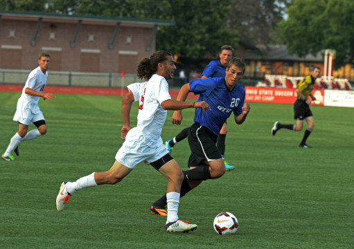 Then-junior midfielder Yianni Saris (6) dribbles the ball in an exhibition game against IPFW Aug. 20, 2013. OSU won 2-0. Credit: Lantern file photo
