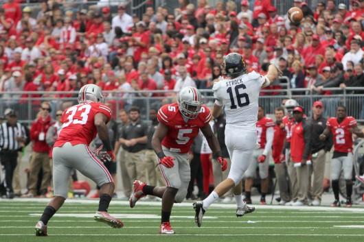 Freshman linebacker Raekwon McMillan goes for a tackle during a game against Kent State on Sept. 13 at Ohio Stadium. OSU won 66-0. Credit: Mark Batke / Photo editor