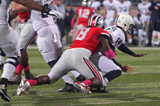 Then-sophomore defensive lineman Noah Spence (8) tackles Penn State then-freshman quarterback Christian Hackenberg during a game at Ohio Stadium on Oct. 26. OSU won, 63-14. Credit: Lantern file photo