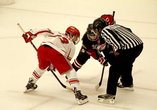 Then-freshman forward Katie Matheny (23) prepares for a face-off during a game against the Toronto Aeros on Sept. 28,2013, at the OSU Ice Rink. OSU lost, 2-1. Credit: Chelsea Spears / Multimedia editor