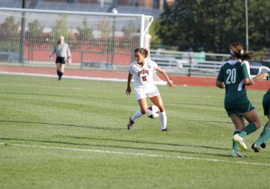 Then-junior midfielder Ellyn Gruber dribbles during a game against Eastern Michigan Aug. 25, 2013. OSU won, 2-1. Lantern file photo