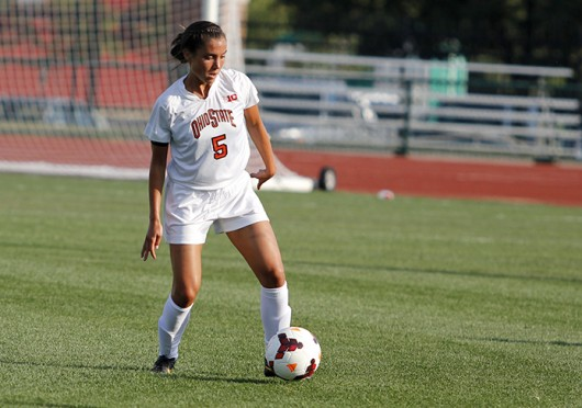 Then-junior Ellyn Gruber dribbles the ball in a game against Eastern Michigan Aug. 25, 2013. OSU won in overtime, 2-1.  Credit: Lantern file photo