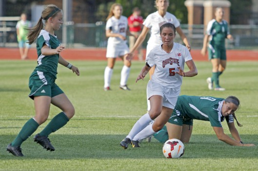 Then-junior midfielder Ellyn Gruber (5) dribbles the ball during  a game against Eastern Michigan on Aug. 25, 2013. OSU won, 2-1, in overtime. Credit: Lantern file photo