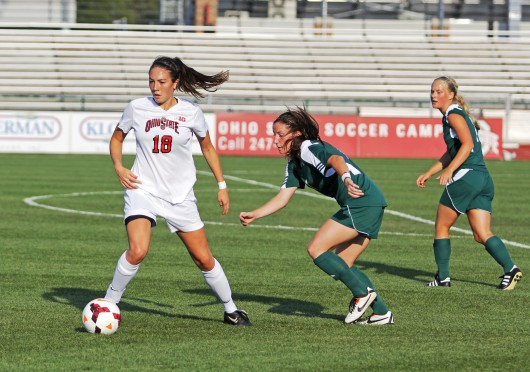 Then-sophomore forward Lindsay Agnew (18) dribbles the ball during a game against Eastern Michigan on Aug. 25, 2013, at Jesse Owens Memorial Stadium. OSU won, 2-1, in overtime. Credit: Lantern file photo