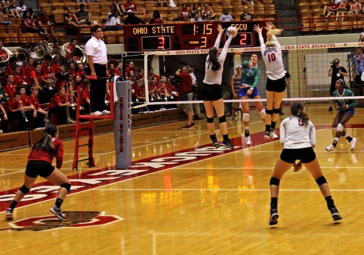 Sophomore middle blocker Taylor Sandbothe (10) and junior outside hitter Katie Mitchell (17) go for a block during a match against FGCU on Sept. 5 at St. John Arena. OSU won, 3-1. Credit: Emily Yarcusko