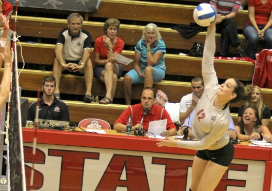 Then-junior outside hitter Erin Sekinger (12) spikes the ball during a match against Dabrowa Sept. 4, at St. John Arena. OSU won, 3-2. Credit: Lantern file photo