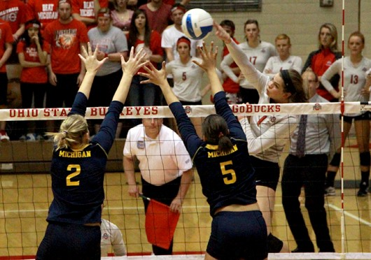 Then-freshman outside hitter Kylie Randall (1) delivers a spike against Michigan on Friday, Sept. 27, 2013 at St. John Arena in Columbus, Ohio. OSU won 3-1.  Credit: Lantern file photo