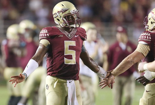 Redshirt-sophomore FSU quarterback Jameis Winston celebrates after a touchdown during a game against The Citadel at Florida State University at Doak Campbell Stadium in Tallahassee, Fla., on Saturday, September 6, 2014. FSU won 37-12 Credit: Courtesy of MCT
