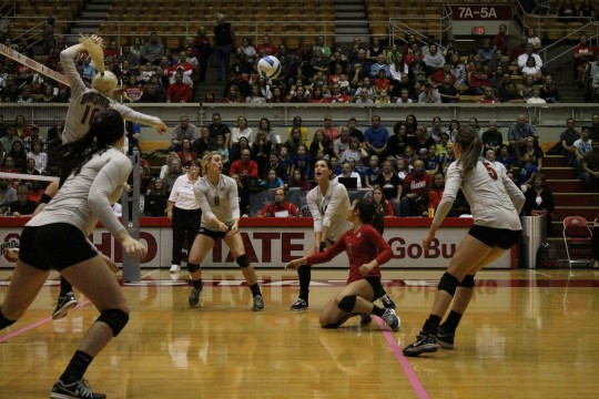 OSU junior outside hitter Elizabeth Campbell (14) defends a hit by Michigan State on Oct. 24 at St. John Arena.