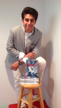 Frank Berardi, a first-year in political science and journalism, poses with his novel 'Voice.' Credit: Courtesy of Frank Berardi