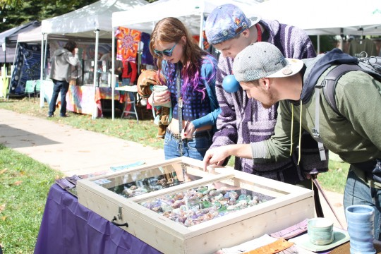 Attendees look at glass pipes at Hempfest Oct. 11, 2014, on the South Oval.