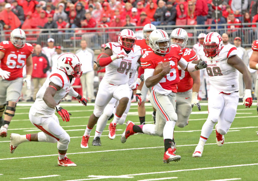 OSU redshirt-freshman quarterback J.T. Barrett (16) runs through the Rutgers defense toward the end zone during an Oct. 18 game at Ohio Stadium. OSU won, 56-17.  Credit: Mark Batke / Photo editor