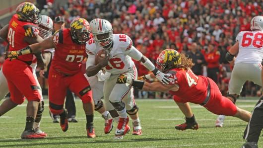 Redshirt-freshman quarterback J.T. Barrett (16) runs the ball during a game against Maryland on Oct. 4 at Byrd Stadium in College Park, Md. OSU won, 52-24. Credit: Mark Batke / Photo editor