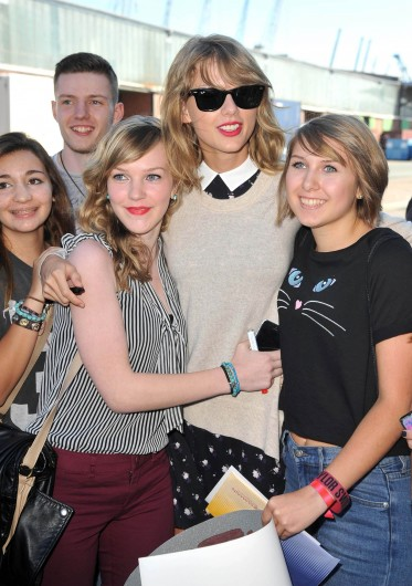 Pop singer Taylor Swift poses with fans before the 5th German Radio Awards on Sept. 4 in Hamburg, Germany.  Credit: Courtesy of TNS