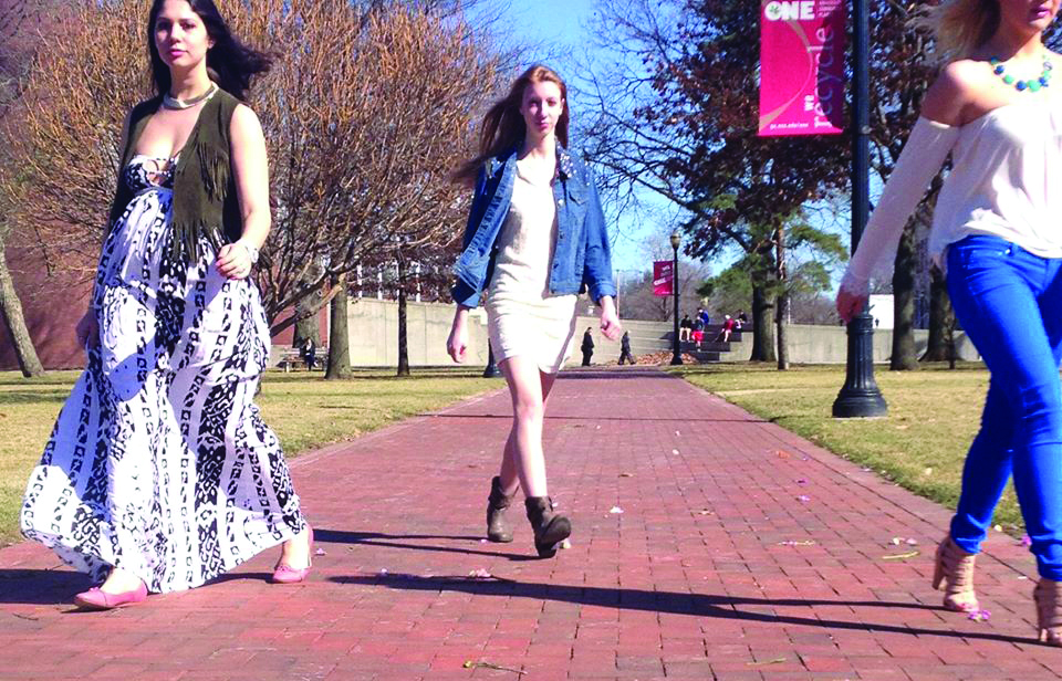Sami Kassirer (left), Krystal Swanson and Christina Dawes walk through the Oval for a marketing video produced by the OSU Fashion Production Association. The organization posted the photo on its Facebook page. Credit: Courtesy of the OSU Fashion Production Association