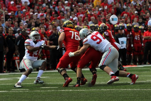 Sophomore defensive lineman Joey Bosa (97) makes a tackle during a game against Maryland on Oct. 4 at Byrd Stadium in College Park, Md. OSU won, 52-24, as Bosa tallied 1 sack and 2.5 tackles for loss. Credit: Mark Batke / Photo editor