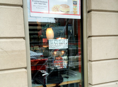 Man throws rock at Buckeye Donuts, cracks window