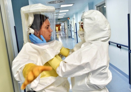 Medical staff wear protective suits as an isolation ward is prepared at Sacco hospital in Milan, Italy Oct. 22 in readiness for any potential Ebola outbreak. Credit: Courtesy of TNS