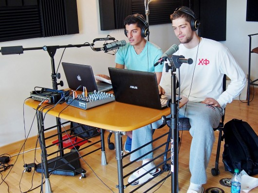CLLC Radio DJs Sid Fragoulis (left), a second-year in exploration, and Nick Galouzis, a fourth-year in modern greek, conduct their first live broadcast of the semester to listeners. Credit: Courtesy of CLLC Radio